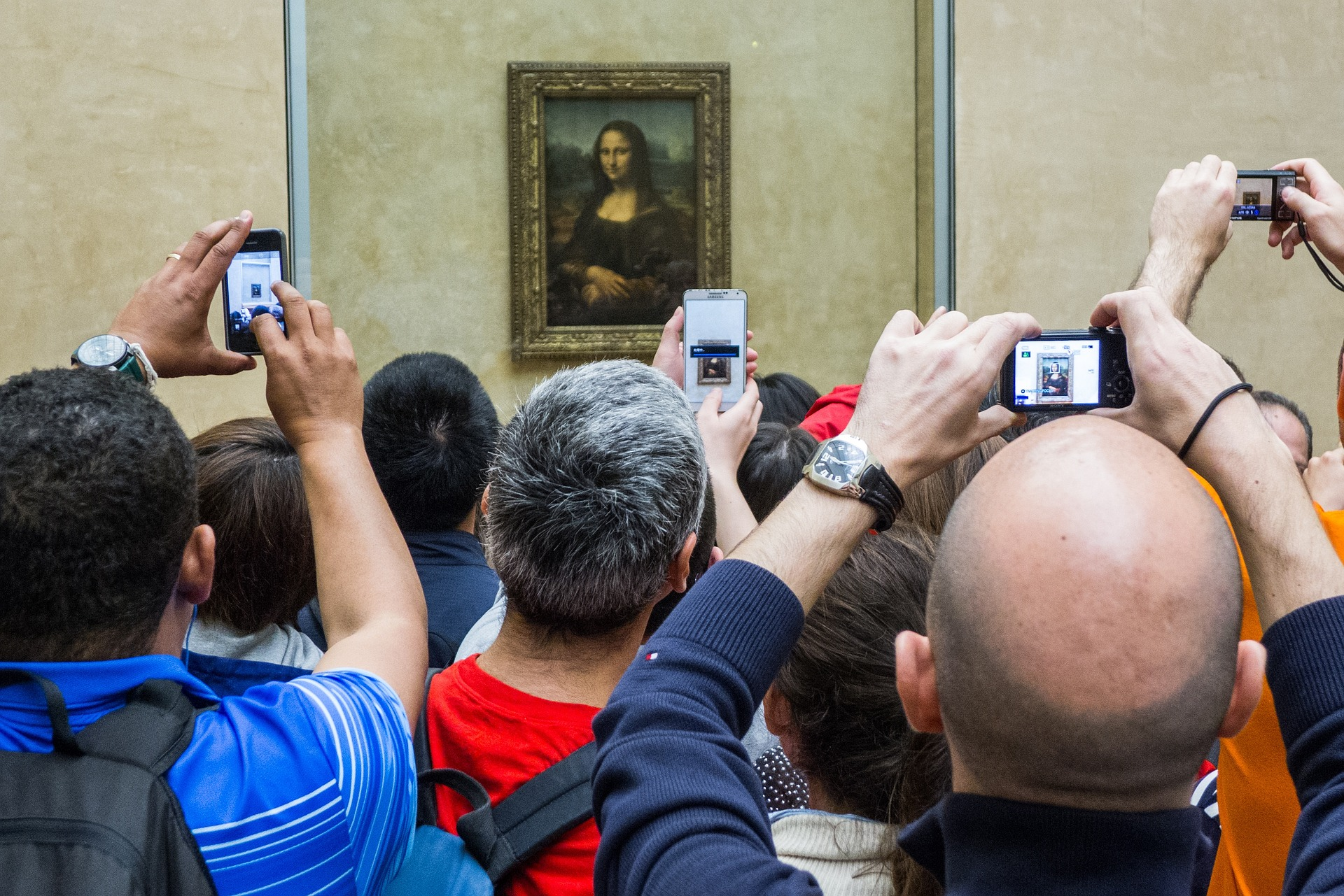 Crowds taking photos of Mona Lisa at the Louvre, Paris